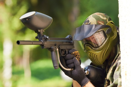 paintball player holding fire photo