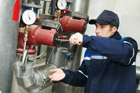 heating engineer repairman in boiler room Stock Photo - 9920652