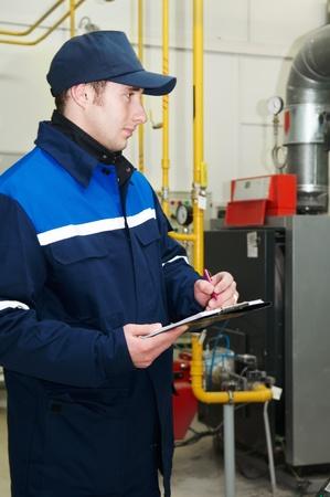 heating engineer repairman in boiler room photo