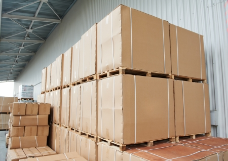warehouse equipment: warehouse cardboard boxes arrangement outdoors Stock Photo