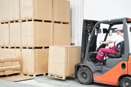 worker driver at warehouse forklift loader works photo
