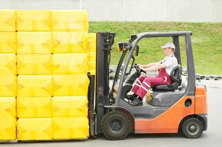 worker driver at warehouse forklift loader works photo