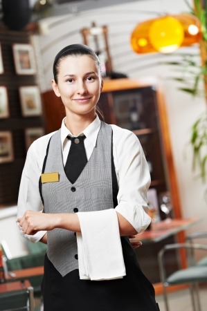 Waitress girl of commercial restaurant photo