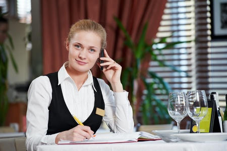booking: restaurant manager woman at work place