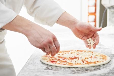 pizza chef: Pizza preparartion Stock Photo
