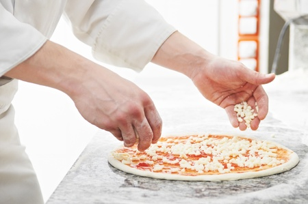 haciendo pan: Preparartion Pizza Foto de archivo