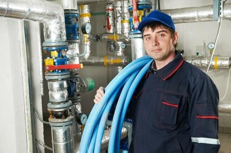 heating engineer repairman in boiler room Stock Photo - 9920579