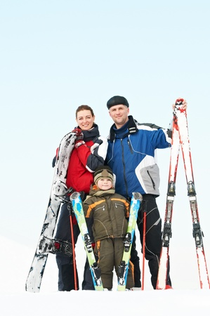 Happy sporty family at winter  photo