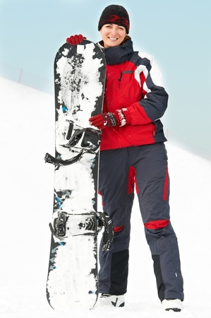 Happy woman with snowboard photo
