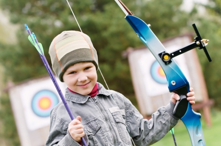 archery target: Child Archer with bow and arrows Stock Photo