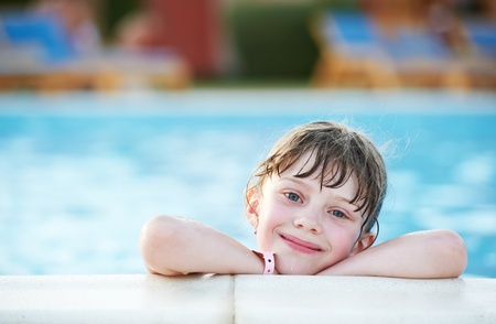 little girl at swimming pool photo