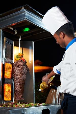 kabob: Arab chef making kebab