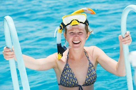 smiling woman with snorkel equipment photo