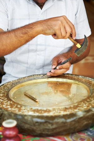 engraver: calker handwork of brass plate Stock Photo