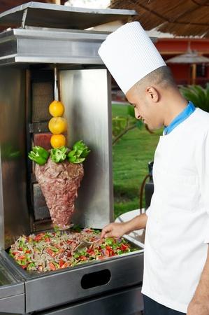 Arab chef making kebab photo