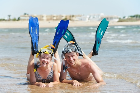 travel gear: active couple at sea beach with snorkel  set Stock Photo
