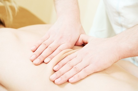 manual medical massage technique Stock Photo - 10378412