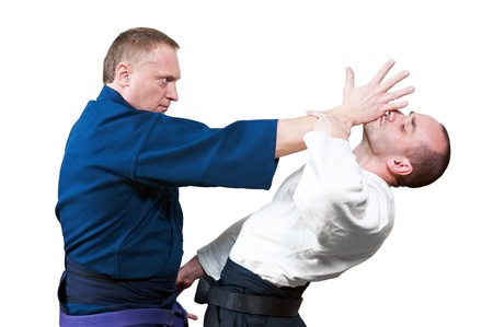 Sparring of two jujitsu fighters photo