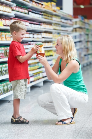 woman and boy making shopping photo