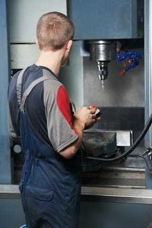 machining center: worker at machining tool workshop Stock Photo
