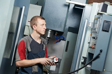 operative: worker at machining tool workshop Stock Photo