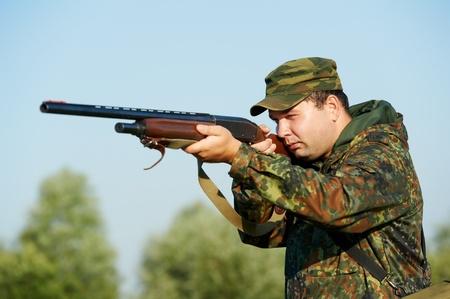 shotgun: hunter with rifle gun Stock Photo