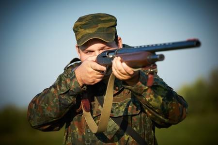 hunt: hunter with rifle gun Stock Photo