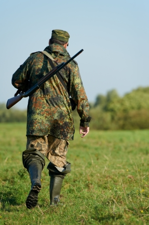 hunter with rifle gun photo
