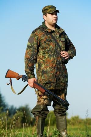 hunter with rifle gun photo