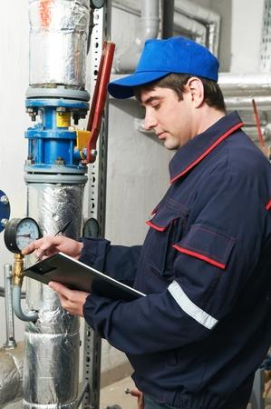 heating engineer repairman in boiler room Stock Photo