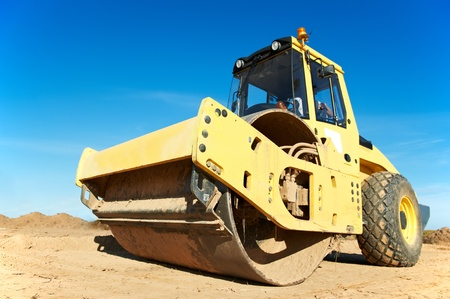 construction vibroroller: Compactor at road compaction works