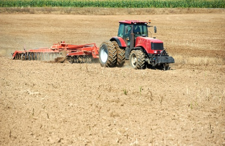 plough land: Ploughing tractor at field cultivation work
