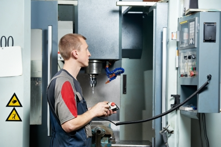 setup man: worker at machining tool workshop Stock Photo