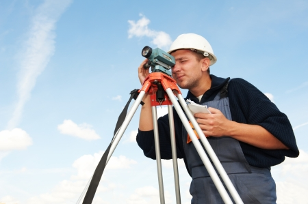 surveyor: surveyor works with theodolite Stock Photo