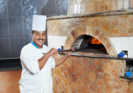 bakers: Arab baker chef making Pizza Stock Photo