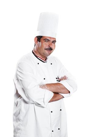 chef in uniform at kitchen photo