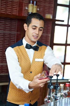 non alcoholic: Cheerful arab barman