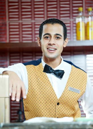 Cheerful arab barman photo