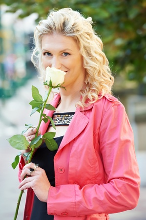 Girl with flower outdoors photo