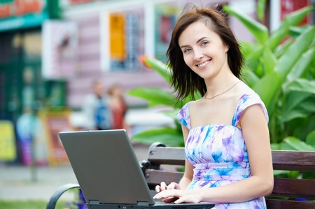 Smiling woman with laptop photo