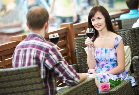 Man and girl with wine at cafe on a date Stock Photo - 10521398