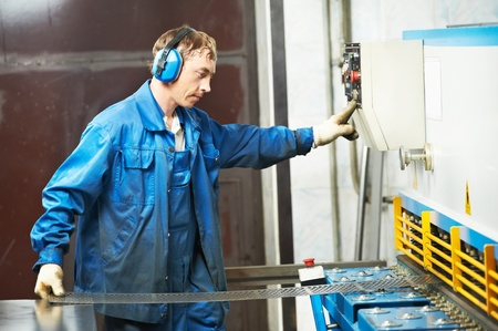 worker operating guillotine shears machine Stock Photo - 10521410