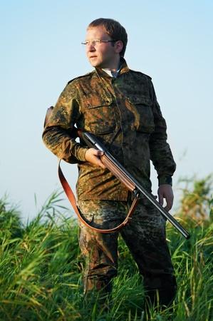 hunter with rifle gun Stock Photo - 10543516