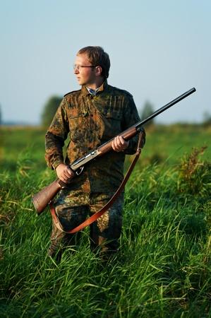hunting rifle: hunter with rifle gun Stock Photo