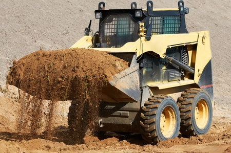 skid loader: skid steer loader at earth moving works