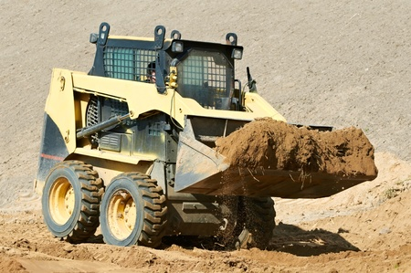 skid steer loader at earth moving works photo