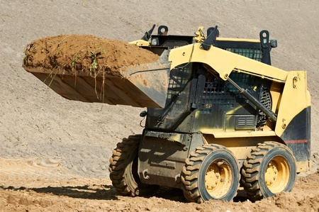wheel loader: skid steer loader at earth moving works