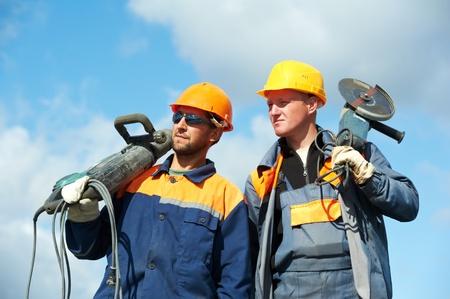 bouwvakkers met elektrisch gereedschap Stockfoto