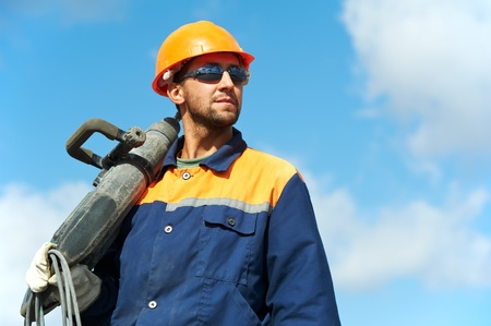 portret van bouwvakker met perforator Stockfoto