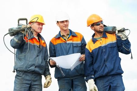 presslufthammer: Bauarbeiter mit Elektrowerkzeugen Lizenzfreie Bilder